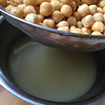 Drain the chick peas, keep back some of the cooking/canning liquid.