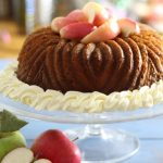 Apple Savarin - A yeasted cake served with poaches apples and cream. www.recipesmadeeasy.co.uk