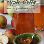 jars of apple jelly behind apple jelly in bowl