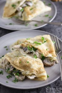 Quick and easy to make savoury pancakes are filled with creamy garlic chicken and mushrooms. recipe by recipesmadeeasy.co.uk