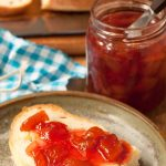 peach and Pomegranate jam spread onto bread by recipes made easy