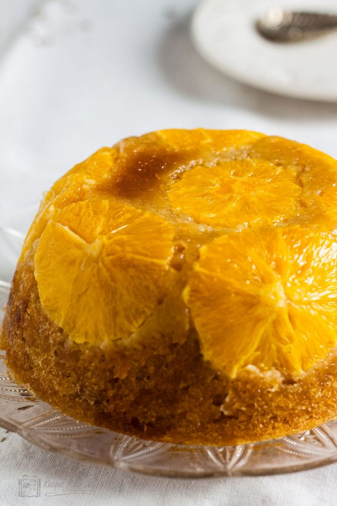 Whole orange and stem ginger pudding on a serving plate -recipes made easy