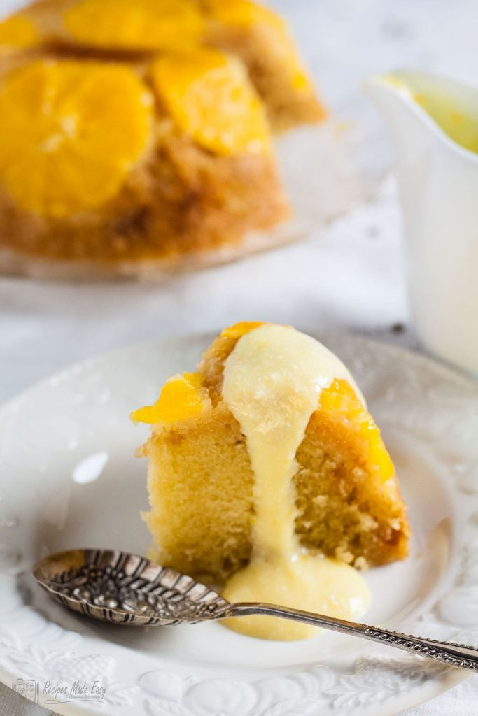 Slice of orange and stem ginger pudding with orange foam sauce poured over. Recipes Made Easy