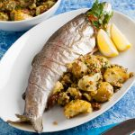 plate of oven baked trout with crushed new potatoes