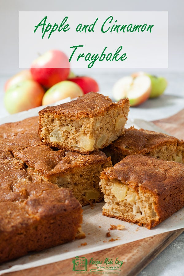 apple and cinnamon traybake cut into squares on a wooden board
