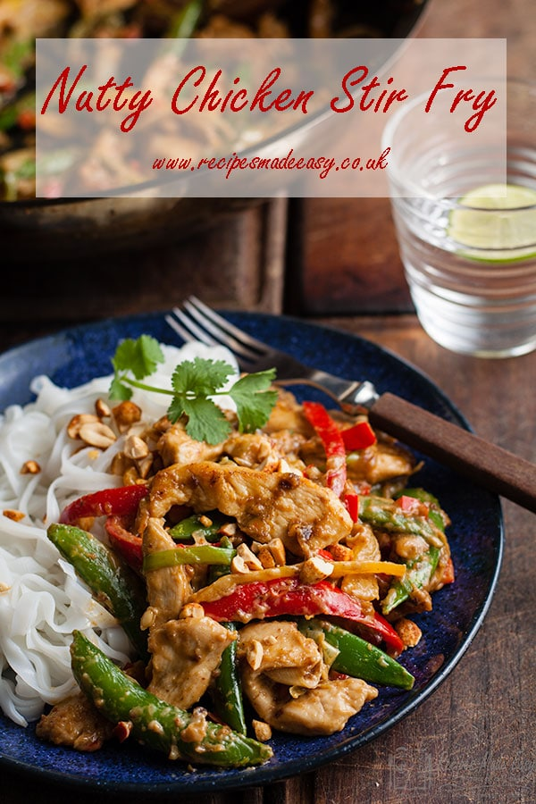 plate of nutty chicken stir fry with recipe name over laid