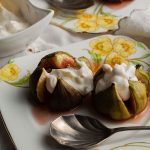 two servings of figs and ginger cream on plates with spoon