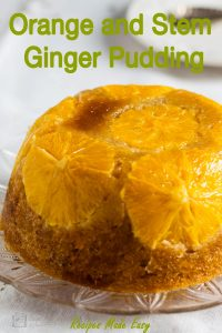 whole orange and stem ginger pudding on a plate.